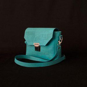 sac à main vegan en liège bleu lagon de l'atelier inua avec fermoir cartable